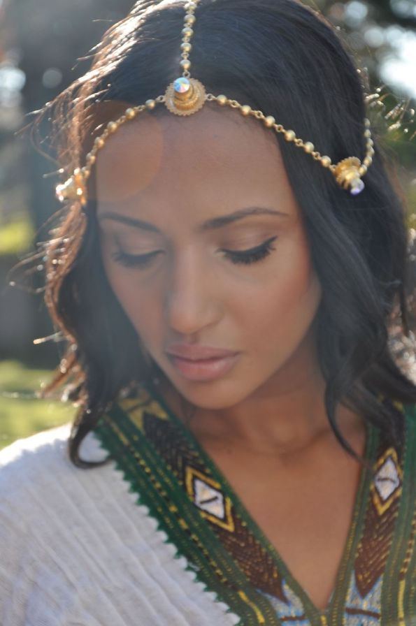 Helena wearing our mother's Eritrean gold head jewelry and Zuria (dress.)