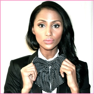 Feven is wearing: H&M bow tie and blouse, Guess blazer, ZARA black tights, MAC make-up, Essie Lollipop red nail polish.