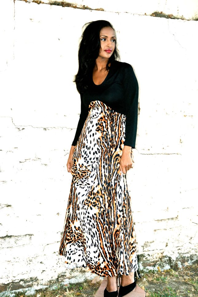 Helena is wearing.... black/animal print vintage maxi : $35.00 black heels: ZARA lipstick: MAC Viva Glam