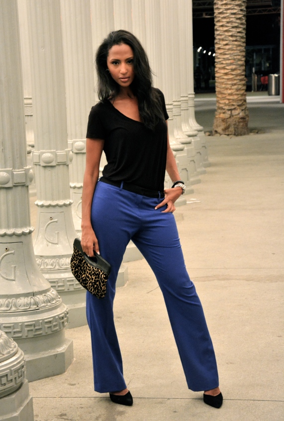 Feven is wearing.... cobalt blue trousers: Calvin Klein black men's v-neck shirt: H&M black heels: ZARA animal print bag: Wastland