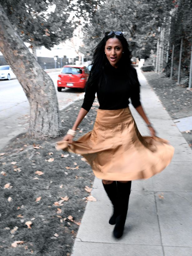Feven is wearing... black turtleneck: GAP golden, pleated: Downtown LA Sunglasses: Fendi black suede boots: Joan & David