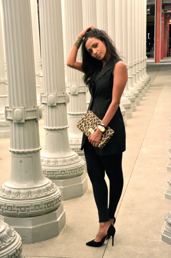 Helena is wearing... oversized black vest: H&M (2 years ago) navy tights: ZARA cuff bracelet: downtown LA animal clutch: H&M